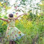 Girl in Butterfly Garden
